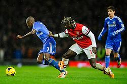 Chelsea Midfielder Ramires (BRA) is tripped by Arsenal Defender Bacary Sagna (FRA) to earn a free kick during the second half of the match - Photo mandatory by-line: Rogan Thomson/JMP - Tel: Mobile: 07966 386802 - 23/12/2013 - SPORT - FOOTBALL - Emirates Stadium - Arsenal v Chelsea - Barclays Premier League.