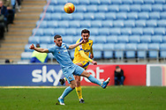 Wimbledon defender Tyler Garrett (12), on loan from Doncaster Rovers, clears during the EFL Sky Bet League 1 match between Coventry City and AFC Wimbledon at the Ricoh Arena, Coventry, England on 12 January 2019.