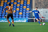 AFC Wimbledon midfielder Jack Rudoni (12) passing the ball down the line during the EFL Sky Bet League 1 match between AFC Wimbledon and Hull City at Plough Lane, London, United Kingdom on 27 February 2021.