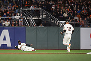 San Francisco Giants center fielder Denard Span (2) makes a diving catch against the Colorado Rockies at AT&T Park in San Francisco, California, on April 14, 2017. (Stan Olszewski/Special to S.F. Examiner)