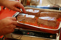 """Lenotre Ecole Culinaire, Paris,..short course - """"Return to the Market"""" with Chef Jacky Legras..taking the temperature of the tuna, to make sure it is rare..photo by Owen Franken for the NY Times..July 12, 2007......."""