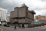 Brutalist concrete architecture of New Street Station Signal Box in Birmingham, United Kingdom. New Street Station has been at the centre of public attention in recent times, with its extensive redevelopment works in full swing. However, at the heart of it, and often overlooked, sits the Grade II listed signal box on Navigation Street, which houses the centre of all rail operations of the station. The corrugated concrete Brutalist structure may polarise public opinion, but is actually home of one of the city's most vital and intense infrastructure systems, serving the busiest rail interchange in the UK. Brutalist architecture is a movement in architecture that flourished from the 1950s to the mid-1970s, descending from the modernist architectural movement of the early 20th century.