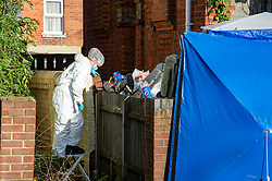 © Licensed to London News Pictures. 12/11/2020. Reading, UK. A forensic investigator moves down a stepladder as she gathers evidence at a property where a man died in the early hours of Thursday. Thames Valley Police is investigating the unexplained  death of a man in Reading. At approximately 04:55GMT South Central Ambulance Service called police officers to a house on Oxford Road, Reading. On attendance they found that a man in his fifties had died. A 44-year-old man, a 38-year-old man and a 43-year-old man all from Reading have been arrested on suspicion of murder. Photo credit: Peter Manning/LNP