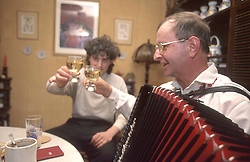 CZECH REPUBLIC MORAVIA BANOV APR98 - Jiri Chovanec (R) clinks glasses with his host during his musical visit at their home during Easter. During Easter, folklore dress, music and mutual visits are part of the customary traditional celebrations in Moravia.  jre/Photo by Jiri Rezac<br /> <br /> © Jiri Rezac 1998<br /> <br /> Tel:   +44 (0) 7050 110 417<br /> Email: info@jirirezac.com<br /> Web:   www.jirirezac.com