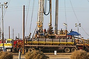 Well stimulation activity on oil well. Lost Hills Oil Field and hydraulic fracking site is located over the Monterey Shale. Kern County, San Joaquin Valley, California, USA