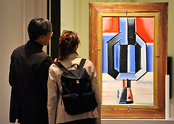 © licensed to London News Pictures. LONDON, UK.  09/06/11. A couple look at a double sided painting by Josef Capek called Sailor and Phantomas estimated to be worth £150,000- 200,000.  Press preview for Sotheby's upcoming Sale of The Hascoe Family Collection of Important Czech Art. Highlights include a group of 20 paintings from Frantisek Kupka, including Movement, which is estimated to fetch £500,000 to £700,000 and Bohumil Kubi?ta's Still Life with Fruit of 1909, estimated at £300,000 to £500,000.  Photo credit should read Stephen Simpson/LNP