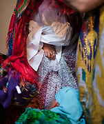 Traditions and events (religious, dance, food etc) for the traditional Pamiri wedding of Said Ulloh (from Khorog) and Sitora (from Barsem village in Ghund valley).<br /> <br /> The town of Khorog (2200m), is the capital of the Gorno-Badakhshan Autonomous Province (GBAO) in Tajikistan. It is situated in the Pamir Mountains (ancient Mount Imeon) at the confluence of the Gunt and Panj rivers.<br /> The city is bounded to the south and to the north by the deltas of the Shakhdara and Gunt rivers, respectively. The two rivers merge in the eastern part of the city flow through the city, dividing it almost evenly until its delta in the river Panj, also being known as Amu Darya, or in antiquity the Oxus on the border with Afghanistan. Khorog is known for its beautiful poplar trees that dominate the flora of the city.<br /> Khorog is one of the poorest areas of Tajikistan, with the charitable organization Aga Khan Foundation providing almost the only source of cash income. Most of its inhabitants are Ismaili Muslims.<br /> <br /> Tajikistan, a mountainous landlocked country in Central Asia. Afghanistan borders it to the south, Uzbekistan to the west, Kyrgyzstan to the north, and People's Republic of China to the east. Tajikistan also lies adjacent to Pakistan separated by the narrow Wakhan Corridor.<br /> Tajikistan became a republic of the Soviet Union in the 20th century, known as the Tajik Soviet Socialist Republic.<br /> It was the first of the Central Asian republic to gain independence in December 1991.