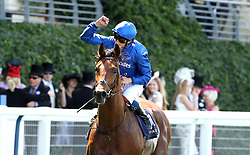 Jockey William Buick celebrates winning the King Edward VII Stakes on Old Persian during day four of Royal Ascot at Ascot Racecourse.