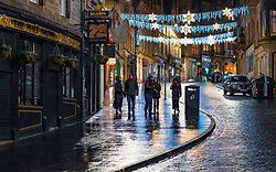 Edinburgh, Scotland, UK. 31 December 2020. Scenes of empty streets at night on Hogmanay in Edinburgh City Centre.Pre Covid-19 pandemic , the city was famous for its street entertainment on New Year's Eve and attracted many thousands of tourists every year to enjoy the New Year celebrations. Pic; Cockburn Street in the Old Town is almost deserted. Iain Masterton/Alamy Live News