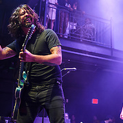 "WASHINGTON, DC - May 5th, 2014 - Dave Grohl and Chris Shiflett of the Foo Fighters perform at the 9:30 Club in Washington D.C. as part of the birthday celebration for Big Tony of Trouble Funk.  The band performed as surprise guests and played a set full of hits such as ""My Hero"" and ""These Days."" (Photo by Kyle Gustafson / For The Washington Post)"