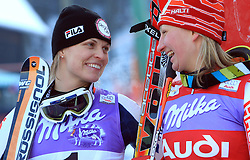 Manuela Moelgg of Italy and Tanja Poutiainen of Finland after second run at Maribor women giant slalom race of Audi FIS Ski World Cup 2008-09, in Maribor, Slovenia, on January 10, 2009. (Photo by Vid Ponikvar / Sportida)