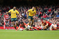Leigh Halfpenny of Wales falls to claim a loose ball.Under Armour 2016 series international rugby, Wales v Australia at the Principality Stadium in Cardiff , South Wales on Saturday 5th November 2016. pic by Andrew Orchard, Andrew Orchard sports photography