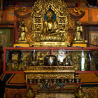 Ornately sculpted altars & deities in Choijinlam Temple, a rare, remaining Tibetan Buddhist sanctuary in Ulaanbaator, Mongolia, a country where monks and lamas were executed after communist takeover.  The religion is making a resurgence after independence