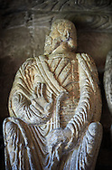 """Early Anglo Saxon sulpture of the an Apostle now part of the south porch of Malmesbury Abbey, Wiltshire, England. The apostles, apart from Peter who holds a crude key, have no distinguishing feature to allow identification. Some are holding books, none have halos and some hold their heads at awkward angles. These three styles are typical of Anglo Saxon art. The two panels are 10 ft long and 4ft 6"""" high are date from the original Ango Saxon church of 705. They were probablbly built into the proch during the Norman rebuilding. The style of these sculptures is of the Roman Byzantine style and were probably sculpted by masions from Gaul.  Malmesbury Abbey, Wiltshire, England .<br /> <br /> Visit our MEDIEVAL PHOTO COLLECTIONS for more   photos  to download or buy as prints https://funkystock.photoshelter.com/gallery-collection/Medieval-Middle-Ages-Historic-Places-Arcaeological-Sites-Pictures-Images-of/C0000B5ZA54_WD0s"""