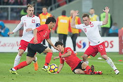 March 27, 2018 - Chorzow, Poland - Kamil Grosicki of Poland vies Chul-soon Choi (KOR), Chang-hoon Kwon (KOR), Maciej Rybus of Poland   during the international friendly soccer match between Poland and South Korea national football teams, at the Silesian Stadium in Chorzow, Poland on 27 March 2018. (Credit Image: © Foto Olimpik/NurPhoto via ZUMA Press)
