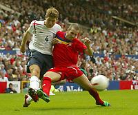 Photo: Aidan Ellis.<br /> England v Andorra. European Championships 2008 Qualifying. 02/09/2006.<br /> England's Steven Gerrard beats Andorra's Antonio Lima Sola to get his cross in
