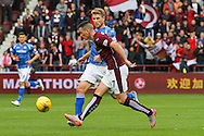 Jamie Walker out runs David Wotherspoon during the Ladbrokes Scottish Premiership match between Heart of Midlothian and St Johnstone at Tynecastle Stadium, Gorgie, Scotland on 2 August 2015. Photo by Craig McAllister.