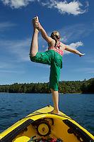 Jessica Laman (age 9) balances on the bow of a kayak on Walden Pond