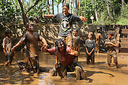 """Mepantigan, a mixture of wrestling, judo and traditional Bali martials arts, based on monkey characters, played in a muddy pool.<br /><br />The Green School (Bali) is one of a kind in Indonesia. It is a private, kindergarten to secondary International school located along the Ayung River near Ubud, Bali, Indonesia. The school buildings are of ecologically-sustainable design made primarily of bamboo, also using local grass and mud walls. There are over 600 students coming from over 40 countries with a percentage of scholarships for local Indonesian students.<br /><br />The impressive three-domed """"Heart of School Building"""" is 60 metres long and uses 2500 bamboo poles. The school also utilizes renewable building materials for some of its other needs, and almost everything, even the desks, chairs, some of the clothes and football goal posts are made of bamboo.<br /><br />The educational focus is on ecological sustainability. Subjects taught include English, mathematics and science, including ecology, the environment and sustainability, as well as the creative arts, global perspectives and environmental management. This educational establishment is unlike other international schools in Indonesia. <br /><br />Renewable energy sources, including solar power and hydroelectric vortex, provide over 50% of the energy needs of the school. The school has an organic permaculture system and prepares students to become stewards of the environment. <br /><br />The school was founded by John and Cynthia Hardy in 2008."""
