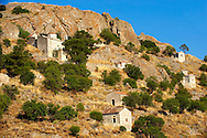 Byzantine chapels of the old Bronze Age  hill village of Paliachora (894),  Aegina - Colonna , Greek Saronic Islands .<br /> <br /> If you prefer to buy from our ALAMY PHOTO LIBRARY  Collection visit : https://www.alamy.com/portfolio/paul-williams-funkystock/aegina-greece.html <br /> Visit our GREECE PHOTO COLLECTIONS for more photos to download or buy as wall art prints https://funkystock.photoshelter.com/gallery-collection/Pictures-Images-of-Greece-Photos-of-Greek-Historic-Landmark-Sites/C0000w6e8OkknEb8
