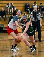 Newfound's Ashlee Dukette charges by Laconia's Sydney Stevens during Monday nights scrimmage at Laconia High School.   (Karen Bobotas/for the Laconia Daily Sun)