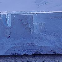 A coastal glacier calves into Gerlache Strait from Anvers Island near the Antarctic Peninsula, Antarctica.