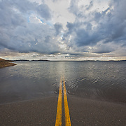Recent Rains from the 2010-2011 winter and high snow melt off from the Sierras puts this road in Folsom Lake, CA under water.