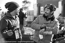 Shinya Kimura greets his teammate Yoshimasa Nimmi after arriving at the finish on the team 80 1915 Indian Twin at the Old Town Museum in Burlington, Colorado for the hosted dinner stop during Stage 8 of the Motorcycle Cannonball Cross-Country Endurance Run, which on this day ran from Junction City, KS to Burlington, CO., USA. Saturday, September 13, 2014.  Photography ©2014 Michael Lichter.