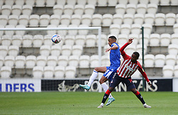 Cohen Bramall of Colchester United gets to the ball befor Dylan Fage of Oldham Athletic - Mandatory by-line: Arron Gent/JMP - 03/10/2020 - FOOTBALL - JobServe Community Stadium - Colchester, England - Colchester United v Oldham Athletic - Sky Bet League Two