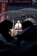 Shii Kazuo, the leader of the Japansese Communist Party (Nihon Kyosanto) , campaigning with candidate, Kimie Hatano, in the rain Yokohama, Kanagawa, Japan, Friday, July 9th 2010