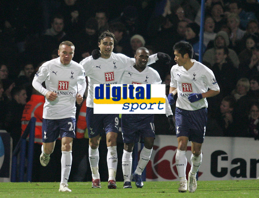 Photo: Lee Earle/Sportsbeat Images.<br /> Portsmouth v Tottenham Hotspur. The FA Barclays Premiership. 15/12/2007. Dimitar Berbatov (2ndL) is congratulated after scoring the winning goal for Tottenham.