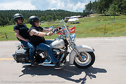 Dawn and James Mobley on the Annual Cycle Source and Michael Lichter Rides (combined this year) left from the new Broken Spoke area of the Iron Horse Saloon during the Sturgis Black Hills Motorcycle Rally. SD, USA.  Wednesday, August 10, 2016.  Photography ©2016 Michael Lichter.