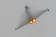 A Typhoon performs a display flight throught eh clouds and rain - The Duxford Battle of Britain Air Show is a finale to the centenary of the Royal Air Force (RAF) with a celebration of 100 years of RAF history and a vision of its innovative future capability.