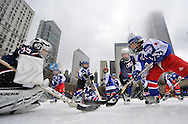 CHICAGO - FEBRUARY 20:  Six-year old Tyler Pan (R) tries to score on goalie Hunter Vaughn, 8, during a youth hockey clinic as part of a Hockey Day in America event at Millennium Park on February 20, 2011 in Chicago, Illinois. The National Hockey League and NBC sponsored the event, which includes a slate of NHL games on Sunday, as part of Hockey Weekend Across America, a nationwide initiative to celebrate the game and those involved at all levels and to expose hockey to new audiences.    (Photo by Brian Kersey/NHLI via Getty Images) *** Local Caption *** Hunter Vaughn; Tyler Pan