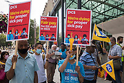 Members of the PCS trade union working for the outsourced contractor ISS stand on the picket line outside their workplace at the Department for Business, Energy and Industrial Strategy BEIS on the second day of a 3-day strike on 20th July 2021 in London, United Kingdom. The striking cleaners, security guards and other support staff at the government department are demanding an end to low pay, improved working conditions, bonuses for having worked through lockdown, annual leave from last year and a Covid return-to-work protocol.