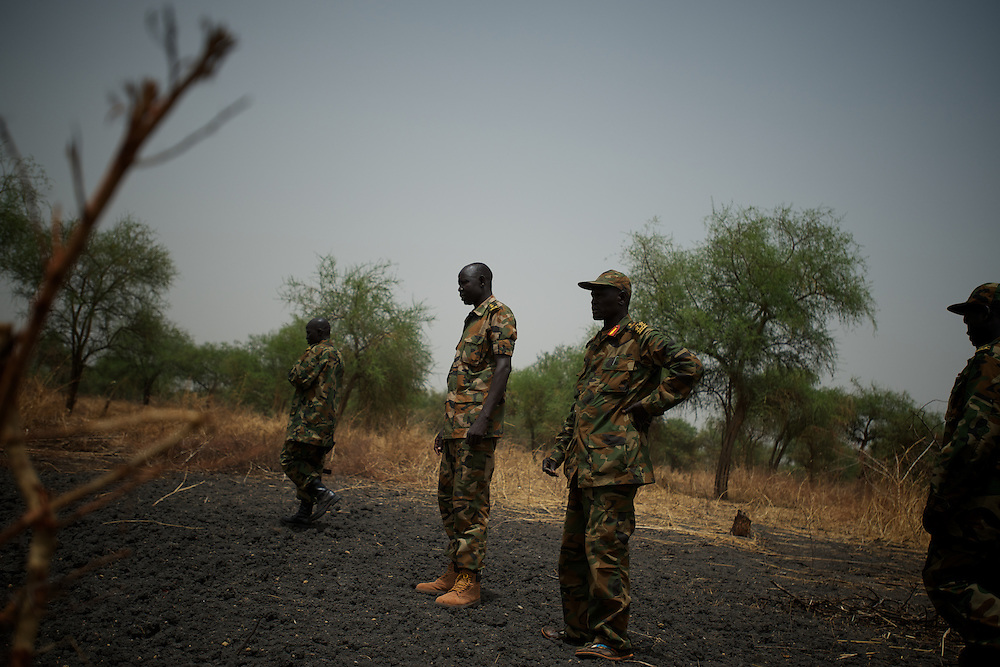 April 24, 2012 - Lalop, South Sudan: SPLA soldiers observe the damage provoked by a bomb  dropped by Sudan's army airplanes, in the outskirts of a newly established military base in the village o Lalop, 50 kilometers north of Bentiu...South Sudan and their northern neighbors, Sudan, have in the past two weeks been involved in heavily clashes over border disputes. Bentiu and neighboring villages have been under constant bombardment by the troops os Karthoum , who established their positions around 10 kilometers into South Sudan's territory. The international community is concerned about the possibility of a full on war between the two countries. (Paulo Nunes dos Santos/Polaris)