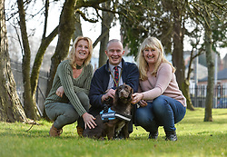 Pictured: Tommy Masters with Antis, and Nina Buckley (left) and Magdalena Luscomb (right) the daughters of Robert Bozdech, a Czech World War 2 airman who was the owner of the original Antis and the inspiration for the charity Bravehound.<br /> <br /> Ex army veteran Tommy Masters from Aboyne can't hide his delight after picking up his new companion dog Antis, a 10 month old spaniel, in Glasgow today. Antis was provided by Scottish-based charity Bravehound, which provides companion and assistance dogs to military veterans throughout the UK.<br /> <br /> © Dave Johnston / EEm