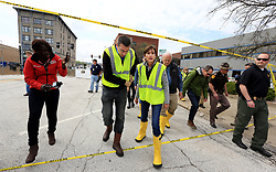 May 3, 2019 - Davenport, Iowa, U.S. - Iowa state senator ROBY SMITH talks with Iowa Gov. KIM REYNOLDS after a stop near the intersection of Pershing Ave. and E 2nd St. in downtown Davenport, during a tour of flooded areas of the community Friday. (Credit Image: © Kevin E. Schmidt/Quad-City Times via ZUMA Wire)