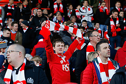 A Bristol City fan holds up his free scarf before the match - Photo mandatory by-line: Rogan Thomson/JMP - 07966 386802 - 25/01/2015 - SPORT - FOOTBALL - Bristol, England - Ashton Gate Stadium - Bristol City v West Ham United - FA Cup Fourth Round Proper.