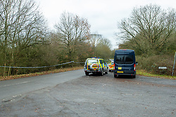 """© Licensed to London News Pictures. 07/12/2019. Gerrards Cross, UK. Police vehicles including a dog unit parked at the corner of Hedgerley Lane and Wapseys Lane as London's Metropolitan Police Service searches woodland in Gerrards Cross, Buckinghamshire. Police have been in the area conducting operations since Thursday 5th December 2019 and are searching two areas on Hedgerley Lane. In a press statement a Metropolitan Police spokesperson said """"Officers are currently in the Gerrards Cross area of Buckinghamshire as part of an ongoing investigation.<br /> """"We are not prepared to discuss further for operational reasons.""""<br /> Photo credit: Peter Manning/LNP"""