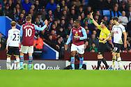 Tottenham's Christian Eriksen is shown a yellow card - Aston Villa vs. Tottenham Hotspurs - Barclay's Premier League - Villa Park - Birmingham - 02/11/2014 Pic Philip Oldham/Sportimage