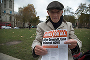 Elderly demonstrator protests around housing policy in Westminster on Budget Day on 22nd November 2017 in London, England, United Kingdom. As the Tories deliver their Autumn Budget, protesters make their views heard outside Parliament.