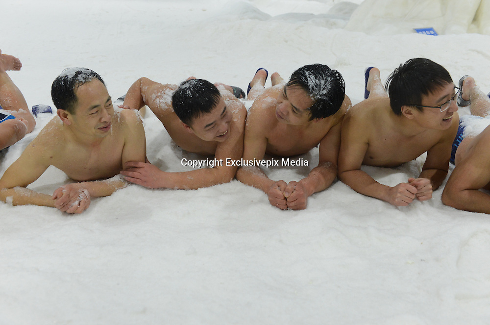 CHANGSHA, CHINA - JANUARY 19: (CHINA OUT) <br /> <br /> Winter Swimming Lovers Lie Down On Snow For Competition In Changsha<br /> <br /> Ten winter swimming lovers lie down on snow with the local temperature of minus 6 degree celsius as they compete that how long they will be stay in snow at Snow Kingdom of Three Pandas on January 19, 2016 in Changsha, Hunan Province of China. The winter swimming lovers would like to call for citizens to exercise even in cold winter. <br /> ©Exclusivepix Media