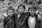 BHUTAN, SHANA VILLAGE, 3 school boys