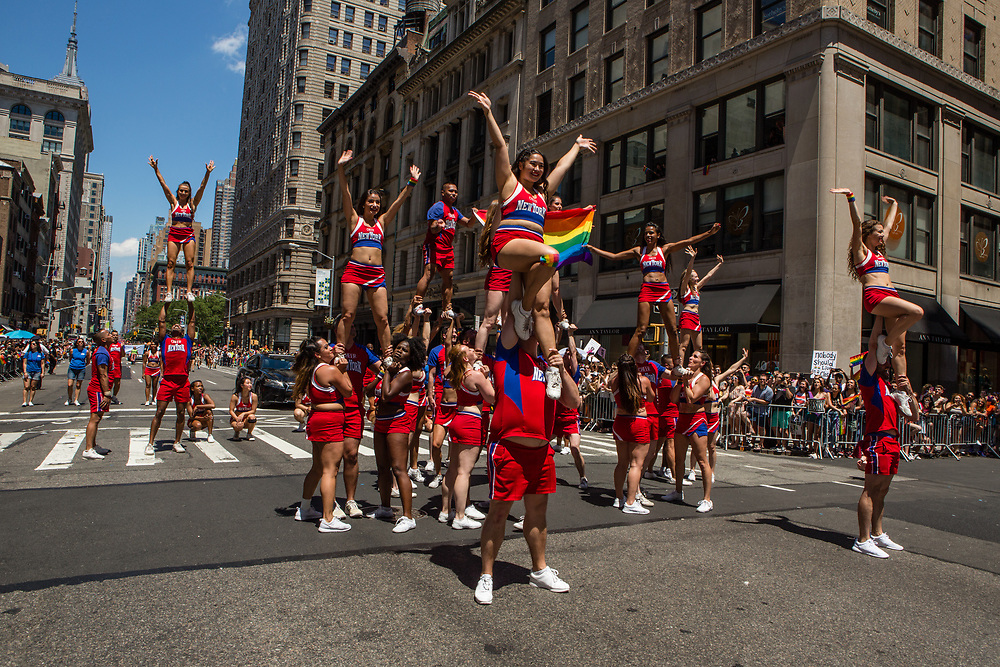 New York, NY - 25 June 2017. New York City Heritage of Pride March filled Fifth Avenue for hours with groups from the LGBT community and it's supporters. A troupe from Cheer New York puts on a demonstration.