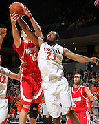 Dec. 07, 2010; Charlottesville, VA, USA;  Virginia Cavaliers forward Mike Scott (23) fights for the rebound with Radford Highlanders forward Tommy Spagnolo (15) during the game at the John Paul Jones Arena. Virginia won 54-44. Mandatory Credit: Andrew Shurtleff
