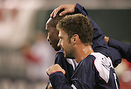 10 February 2006: After scoring the game's first goal in the 27th minute, Eddie Pope (behind) of the U.S. is congratulated by teammate Pat Noonan (r). The United States Men's National Team led Japan 3-0 early in the second half at the Pac Bell Park in San Francisco, California in an International Friendly soccer match.