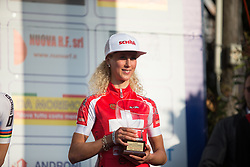 Jolanda Neff (Servetto Footon Cycling Team) holds the prize for her third place in the Trofeo Alfredo Binda - a 123.3km road race from Gavirate to Cittiglio on March 20th 2016.