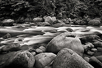 Swift river during spring in the White Mountain National Forest in New Hampshire, black and white