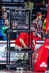 NORMAL, IL - December 07: A member of the facilities crew works to set up an alternate clock when a backboard clock fails during a college basketball game between the ISU Redbirds and the Morehead State Eagles on December 07 2019 at Redbird Arena in Normal, IL. (Photo by Alan Look)